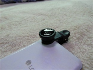 Screw a lens to this clip. Place it over your phone lens.