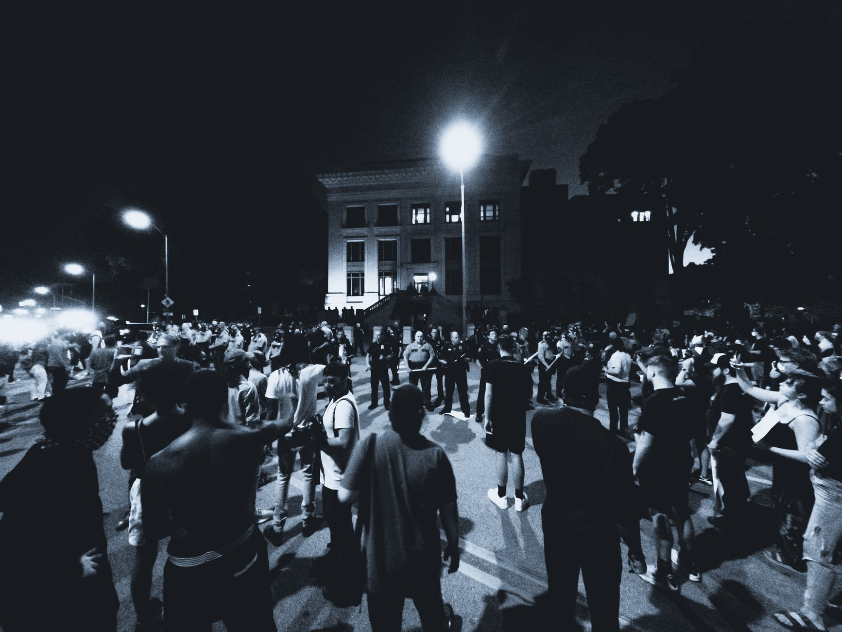 grayscale photo of protesters on a street